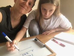 Olivia and Elke doing maths at home